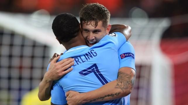 LION HEARTS: Raheem Sterling congratulates John Stones