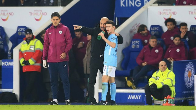 WISE WORDS: Phil Foden takes the manager's instructions on board.