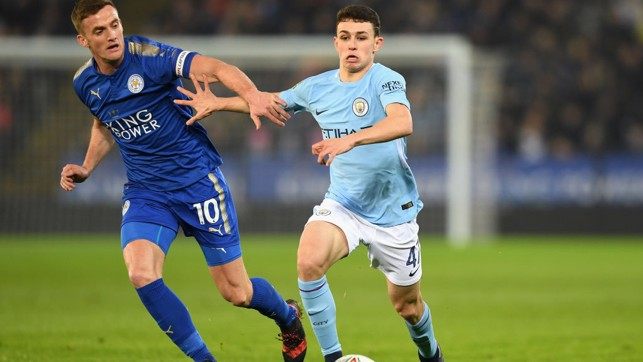 ON THE MOVE: Phil Foden skips past Leicester's Andy King.