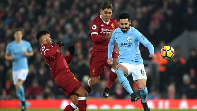 ACTION STATIONS: Ilkay Gundogan in the thick of the action at Anfield