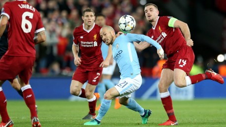 BATTLE: David Silva competes with Liverpool skipper Jordan Henderson.