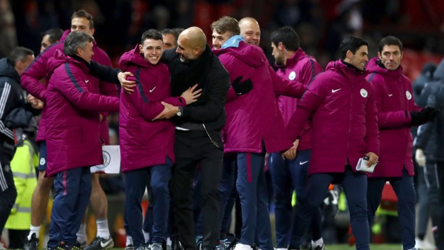 CELEBRATIONS: Pep Guardiola and Phil Foden share their delight at full time.