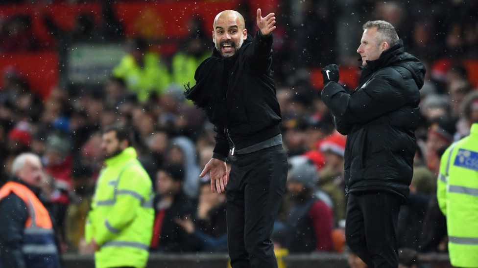 PEP WATCH: The manager issues his instructions from the touchline.