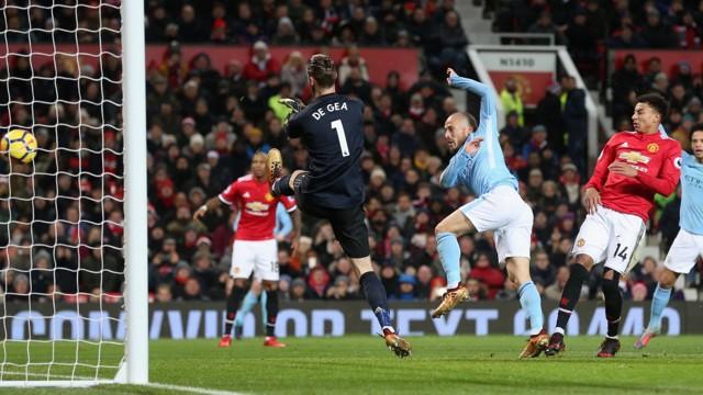 EL MAGO: David Silva puts City ahead in the 42nd minute at Old Trafford.
