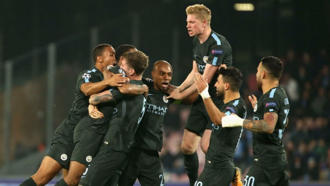 HIGH LIFE: The City players celebrate John Stones' header