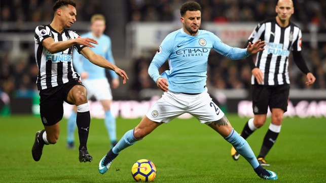SPLITS: Kyle Walker is challenged by Newcastle's Jacob Murphy.