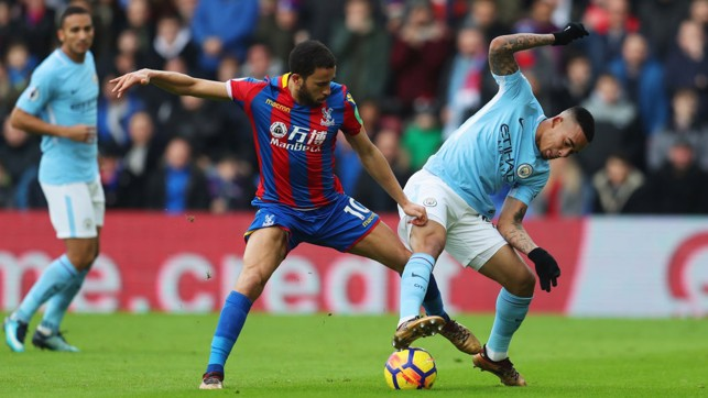 BATTLING: Gabriel Jesus keeps the ball away from Palace's Andros Townsend.