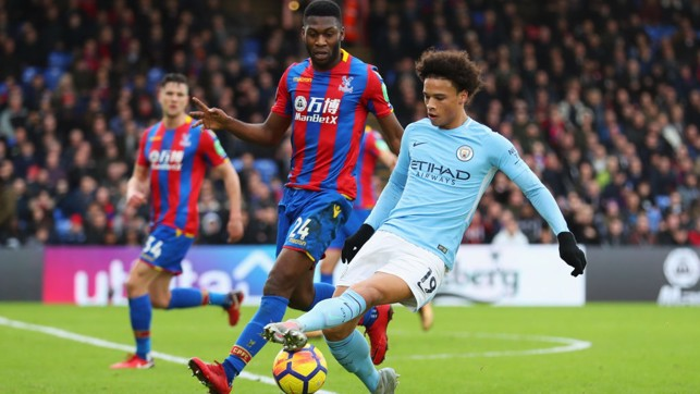 PROBING: Leroy Sané is closely marked by Palace's Tim Fosu-Mensah.