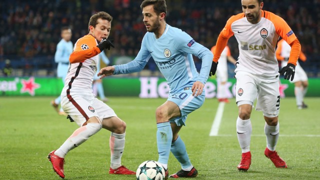 SURROUNDED: Bernardo Silva keeps possession in a confined space.
