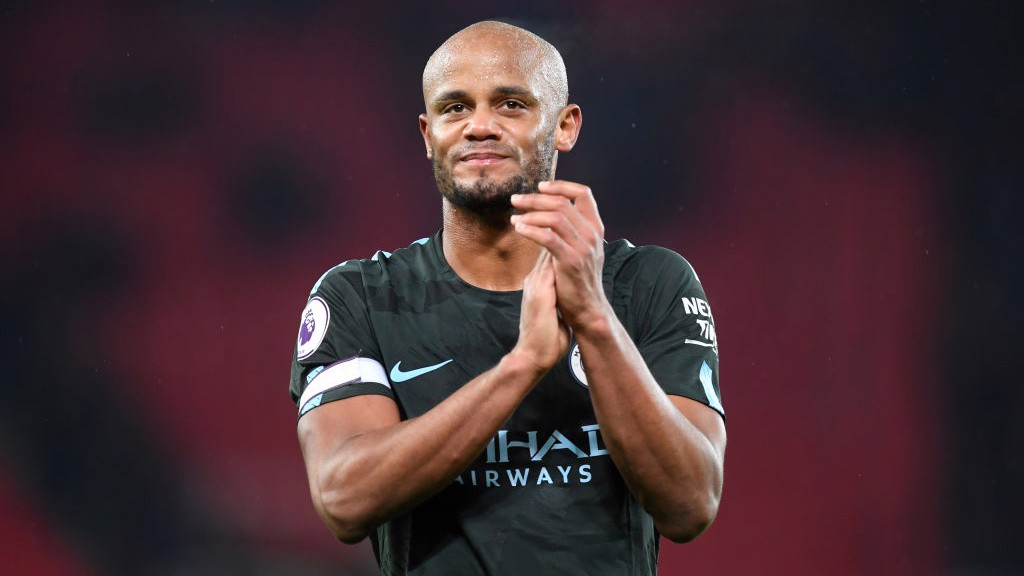 SOLID: Vincent Kompany applauds City's away support.