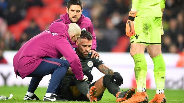 WARRIOR: Nicolás Otamendi plays on with a bloodied head.