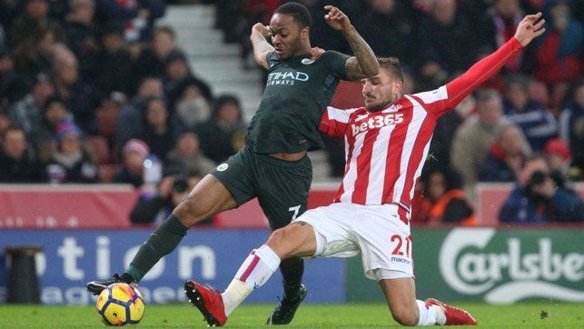PACE: Raheem Sterling negotiates his way past Stoke's Konstantinos Stafylidis.