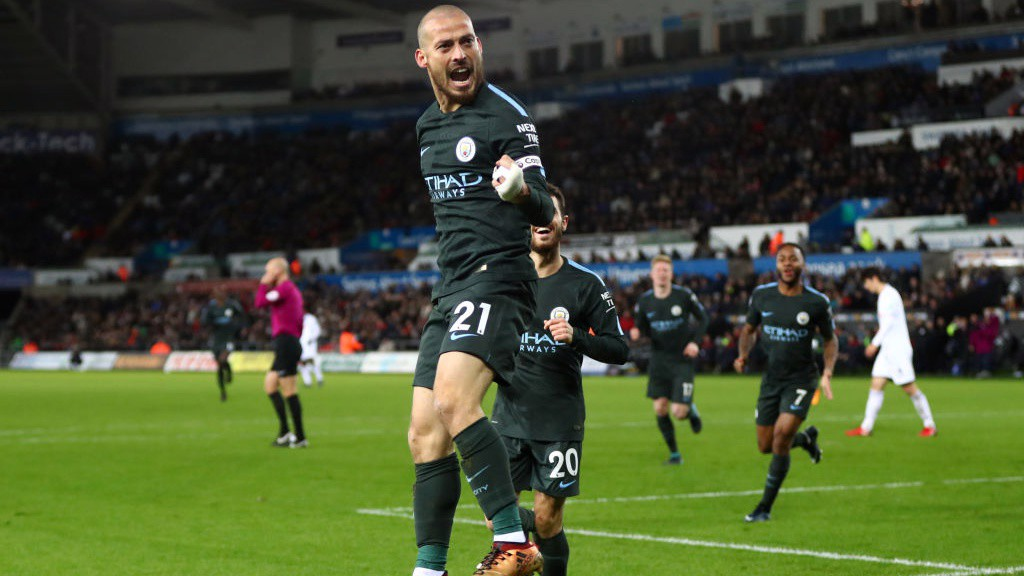 WALKING ON AIR: David Silva celebrates his second of the night. Unstoppable!