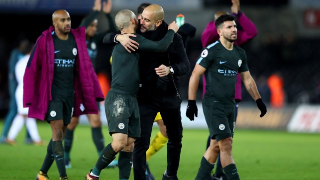 HISTORY BOYS: Pep Guardiola and David Silva celebrate City's record-breaking 15th consecutive league win.