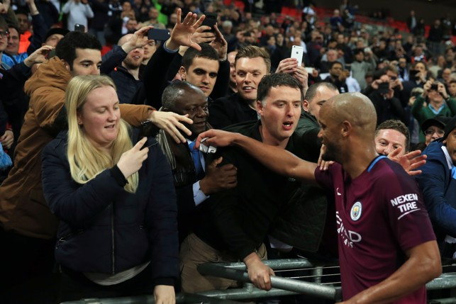 KAPTAIN: Vincent Kompany celebrates with the travelling City fans