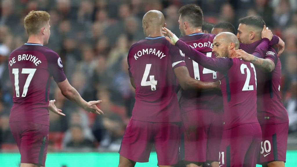 SUPER CITY: The lads celebrate the third