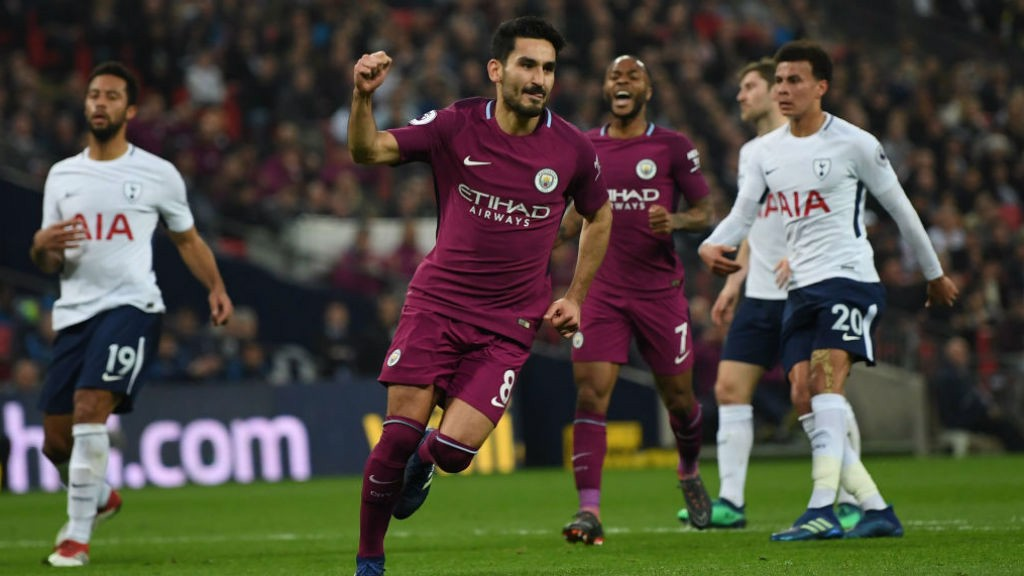 SPOT ON: Ilkay Gundogan wheels away in triumph after firing home from the penalty spot