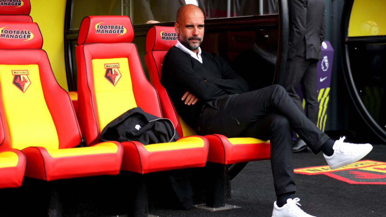 SITTING PRETTY: Pep Guardiola watches over proceedings at Vicarage Road