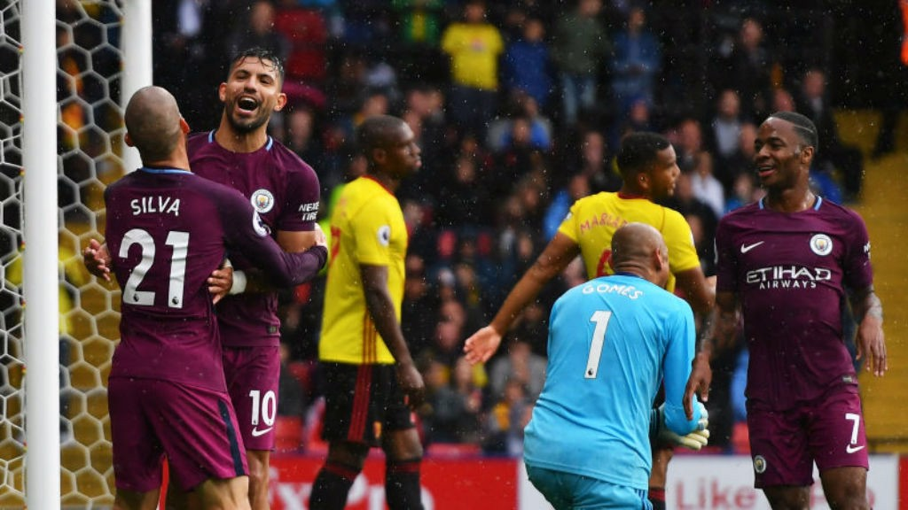 RAIN MAN: Sergio Aguero is singing in the rain after his second goal
