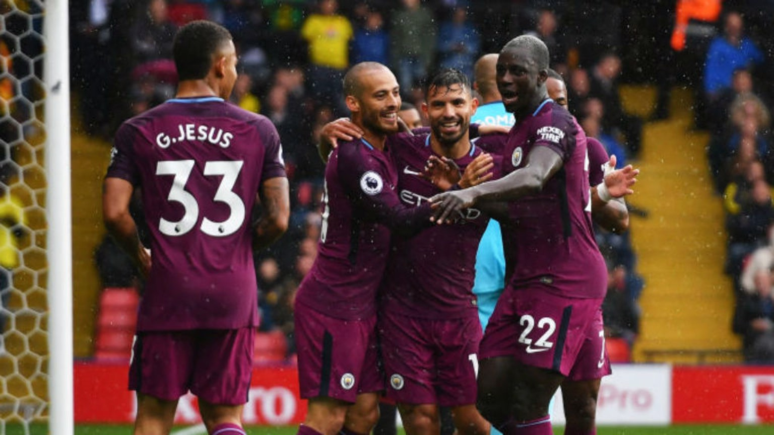 SMILING ASSASSIN: Sergio Aguero is mobbed by his City team-mates