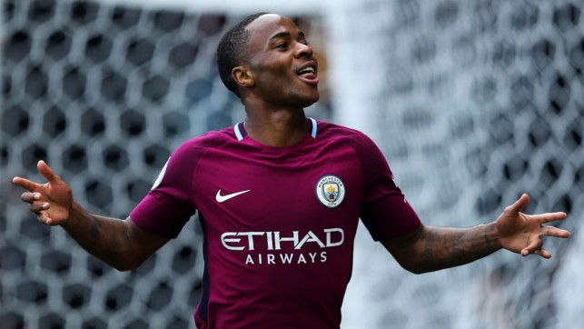SIX PACK: Raheem Sterling is all smiles after converting City's sixth from the penalty spot