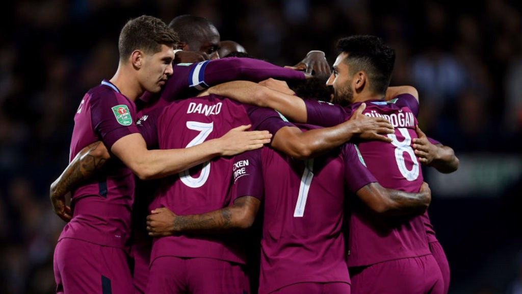 FLYING START: The City players celebrate after Leroy Sane's early strike