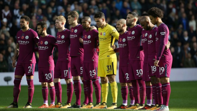 REMEMBRANCE: City observe a minute's silence ahead of the game at the Hawthorns.