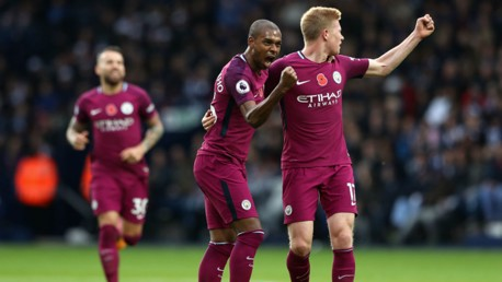 GET IN: Fernandinho and Kevin De Bruyne celebrate the Brazilian's second goal of the campaign.