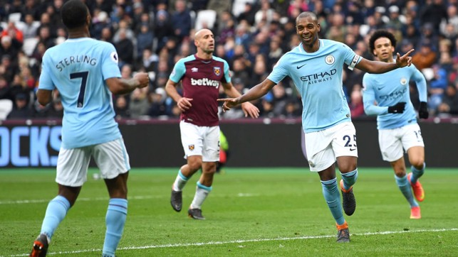 LEADER: Fernandinho celebrates after firing home City's fourth goal.​
