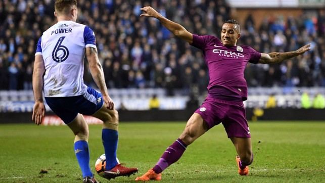 FULL STRETCH: Danilo challenges for the ball.