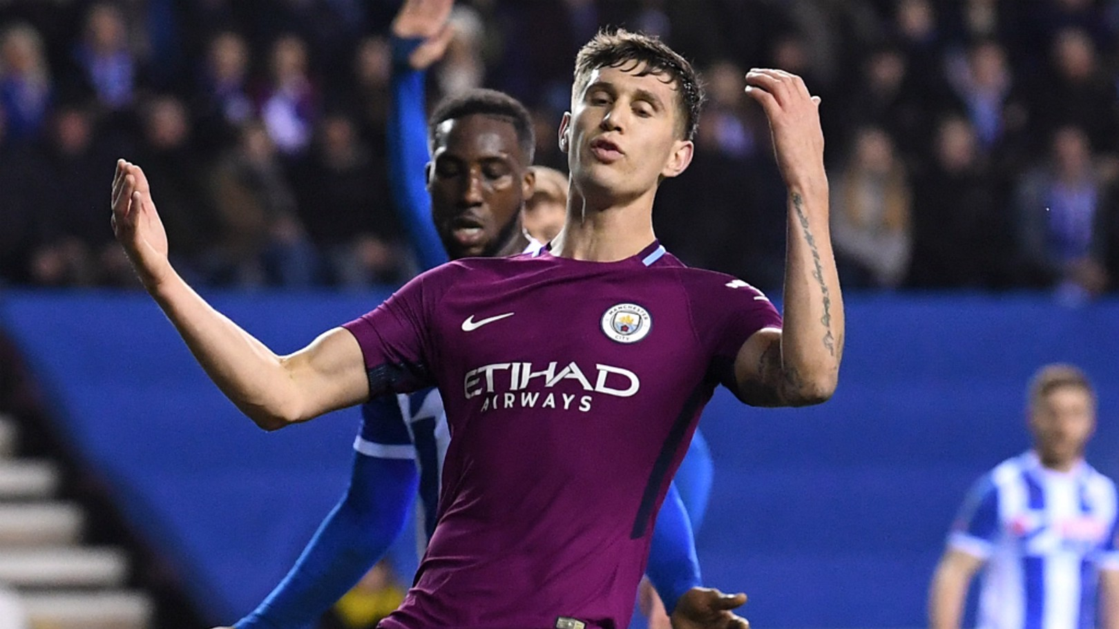 HEARTBREAK: John Stones reacts to City's FA Cup defeat at Wigan...