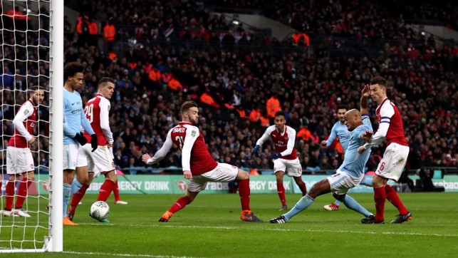 POACHER'S FINISH: Kompany scores City's second in the 2017/18 League Cup Final triumph over Arsenal