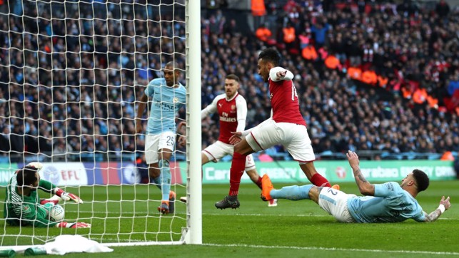EARLY SCARE: Arsenal go close but Kyle Walker denies Pierre-Emerick Aubameyang at the last.