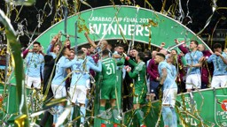 WINNERS: City lift the trophy!