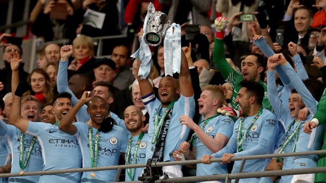 ​CHAMPIONS: Vincent Kompany lifts the Carabao Cup for the third time as City captain