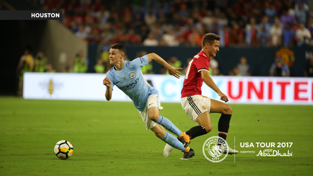 A CITY UNITED: Foden goes by Herrera