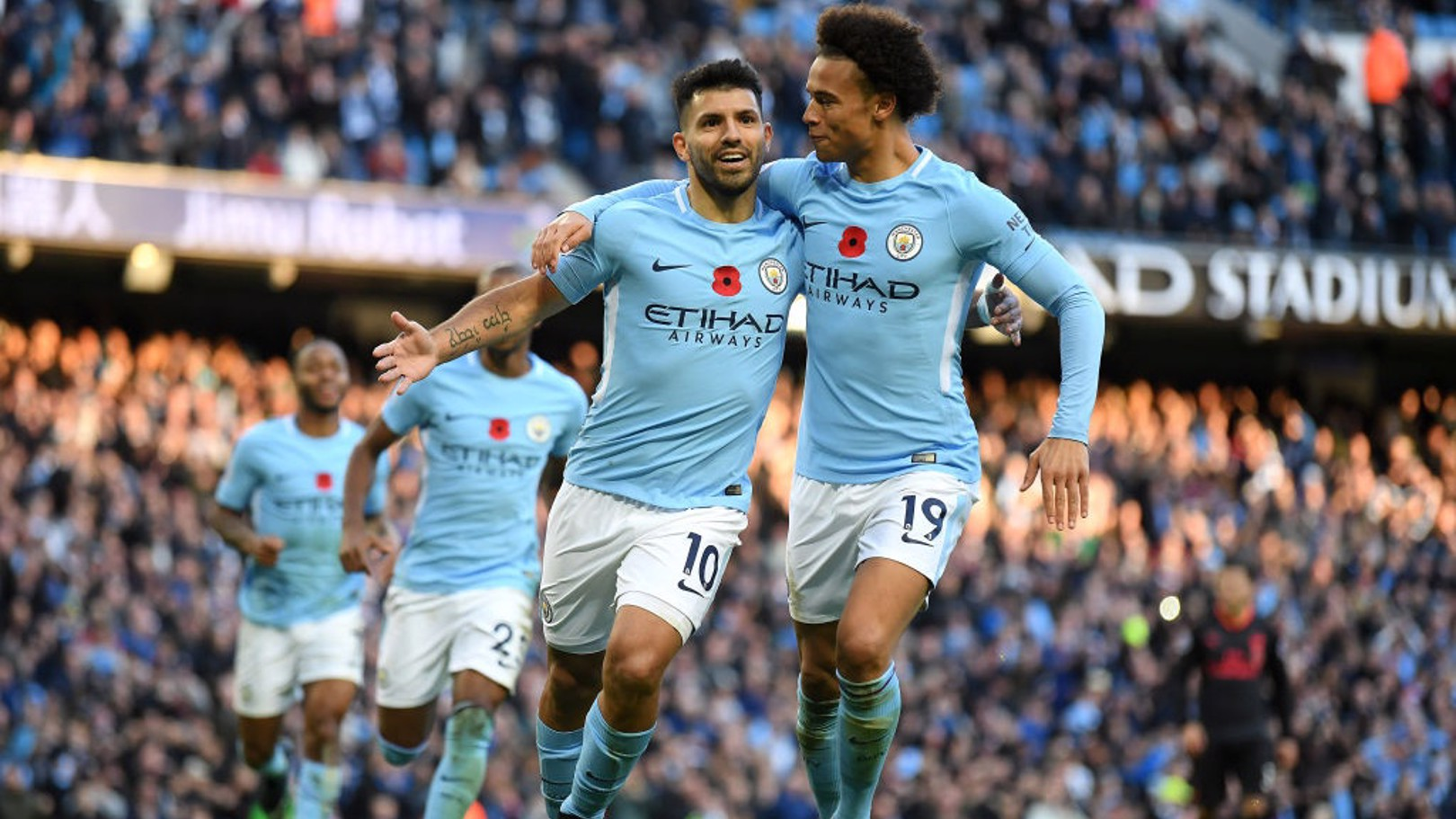179 AND COUNTING: City's record-breaking forward celebrates his penalty strike with Leroy Sané.