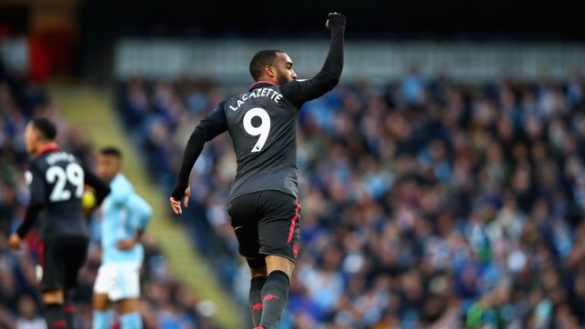SUB SCORES: Alexandre Lacazette celebrates pulling one back for the visitors.