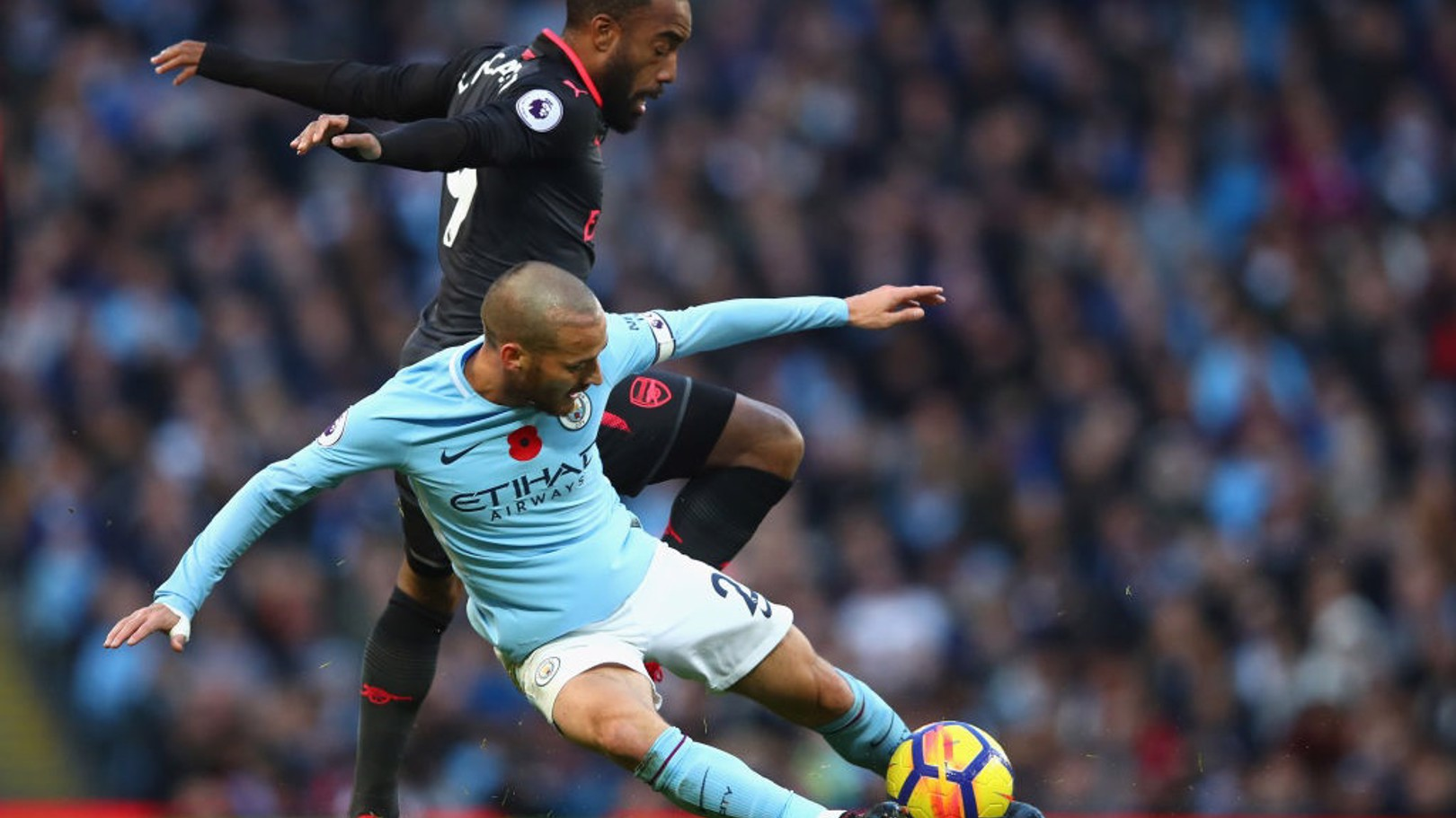 LEADING BY EXAMPLE: Captain David Silva wins the ball from Alexandre Lacazette.