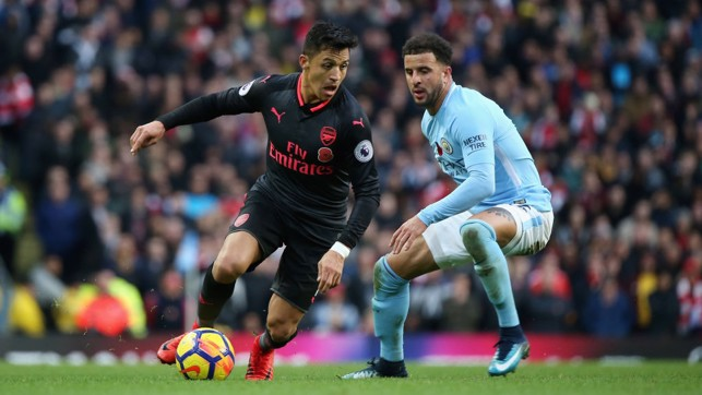 CLOSE QUARTERS: Kyle Walker tracks Arsenal's Alexis Sanchez.