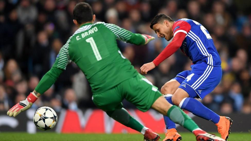 ALERT: Claudio Bravo smothers a shot from Basel's goalscorer.