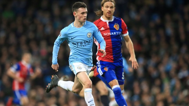 YOUNG GUN: Phil Foden marches forward.