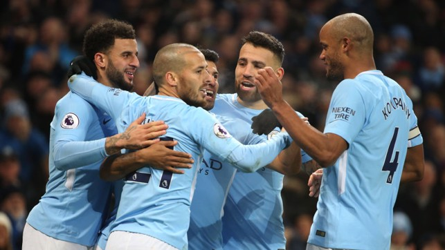 ​AT THE DOUBLE: City celebrate going two ahead against Bournemouth.