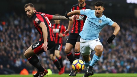 PROBING: Sergio Agüero looks to pierce Bournemouth's defensive line.
