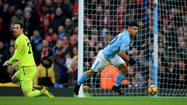 ON TARGET: Sergio Agüero wheels away after putting City in front.