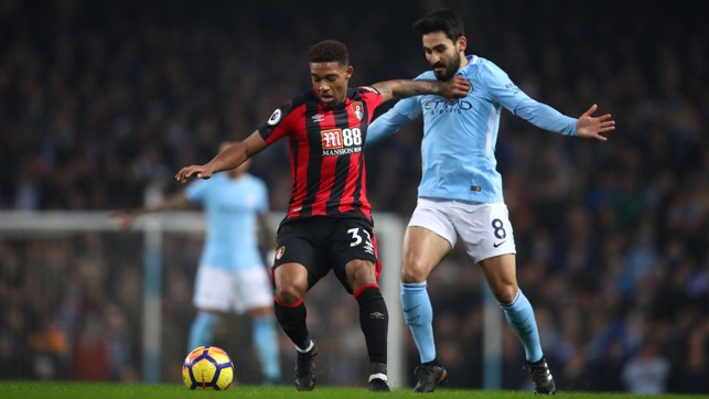 HARRIER: Ilkay Gundogan battles for possession with Jordon Ibe.
