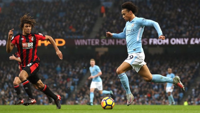ON THE BREAK: Leroy Sané races away from Bournemouth's Nathan Aké.