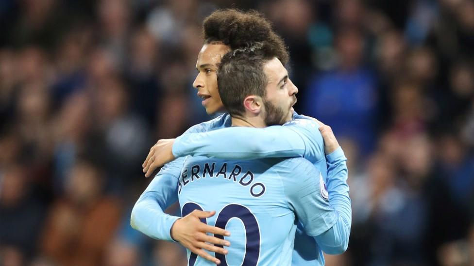 NIGHT UNDER THE LIGHTS: Bernardo celebrates with Sane after slotting home to make it 2-1.