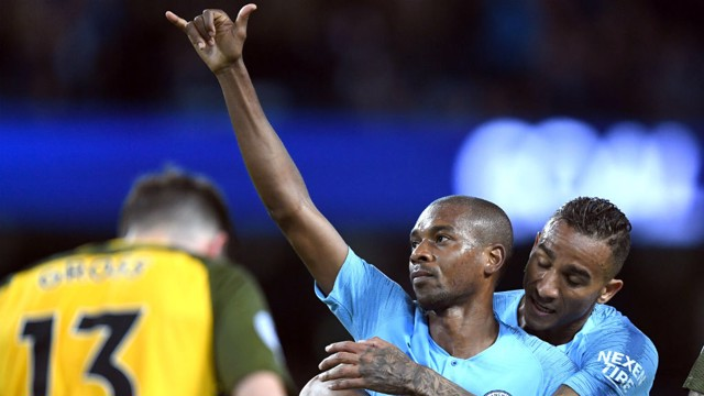 LUCKY THREE: Fernandinho writes his name on the score sheet.