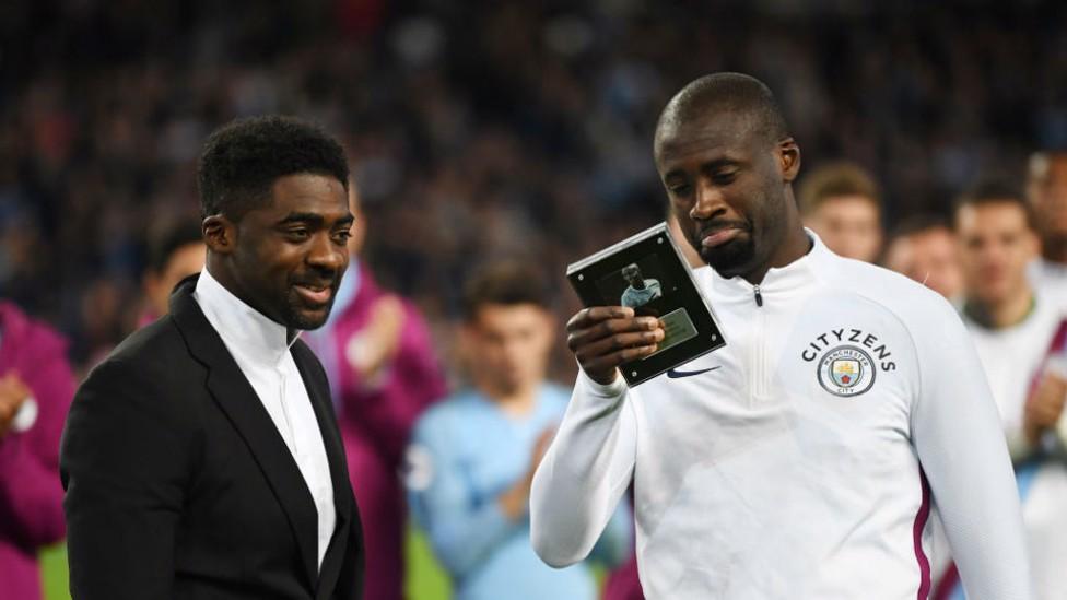 FAMILY AFFAIR: Kolo Toure presents a leaving gift to brother Yaya